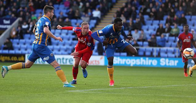Soccer Football - FA Cup First Round - Shrewsbury Town vs Aldershot Town - New Meadow, Shrewsbury, Britain - November 4, 2017 Aldershot Town's Scott Rendell gets a header at goal with Shrewsbury Town's Aristote Nsiala defending Action Images/John Clifton