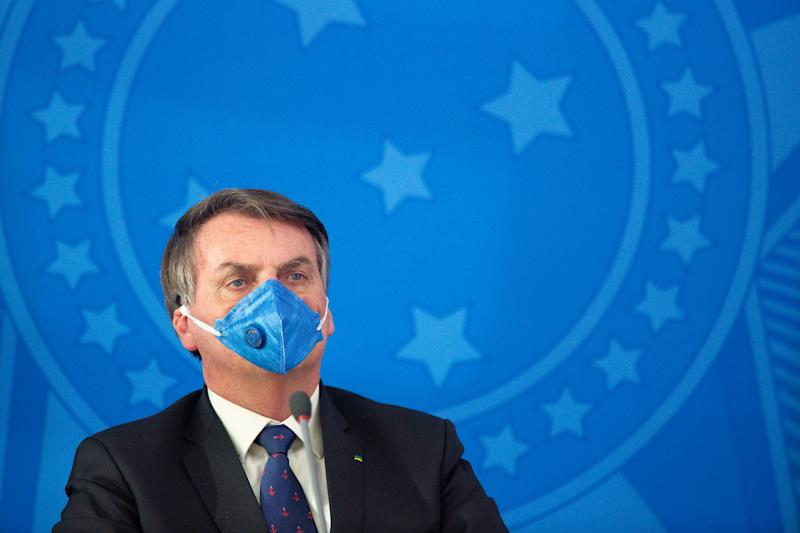 BRASILIA, BRAZIL - MARCH 20: Jair Bolsonaro President of Brazil wears a protective mask during a press conference about outbreak of the coronavirus (COVID - 19) at the Planalto Palace on March 20, 2020 in Brasilia, Brazil. (Photo by Andressa Anholete/Getty Images)