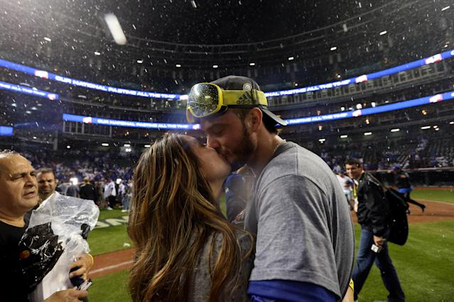 "<a class=""link rapid-noclick-resp"" href=""/mlb/players/9558/"" data-ylk=""slk:Kris Bryant"">Kris Bryant</a> celebrates the World Series with his wife Jess. (Photo by Rob Tringali/MLB Photos via Getty Images)"