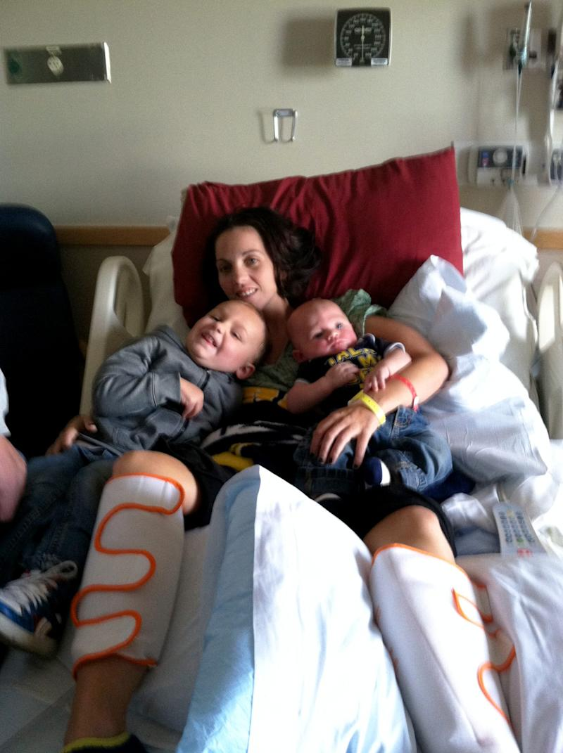 Kaylee Hardenbrook holds her sons, Fritz and Sylas, at the hospital where she was being treated for Eastern equine encephalitis.