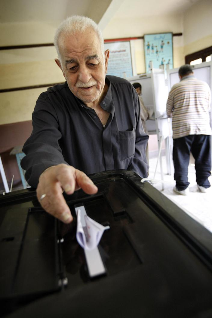 An Egyptian man cast his vote during the second day of presidential elections in the Mataraya neighborhood of Cairo, Egypt, Thursday, May 24, 2012. In a wide-open race that will define the nation's future political course, Egyptians voted Thursday on the second day of a landmark presidential election that will produce a successor to longtime authoritarian ruler Hosni Mubarak. (AP Photo/Frederik Persson)