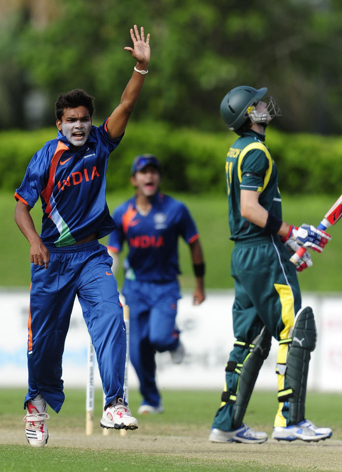 TOWNSVILLE, AUSTRALIA - APRIL 15:  Sandeep Sharma of India celebrates the dismissal of Kurtis Patterson of Australia  during the match between Australia and India on day five of the U19 International Quad Series at Tony Ireland Stadium on April 15, 2012 in Townsville, Australia.  (Photo by Ian Hitchcock/Getty Images)