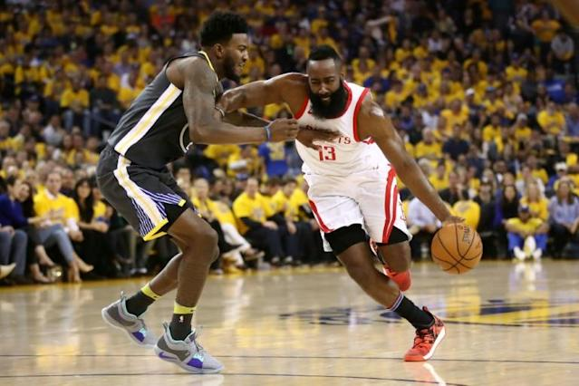 James Harden of the Houston Rockets drives past Jordan Bell of the Golden State Warriors during the 2018 NBA Playoffs in Oakland, California