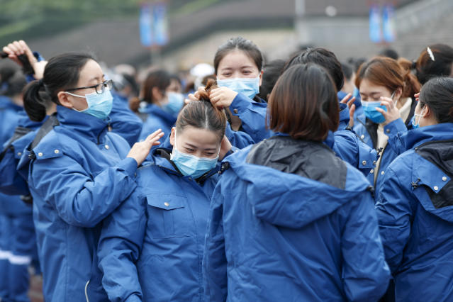 Medical workers gather in the district Chongqing as they prepare to leave for Hubei province, where the outbreak started, on 11 February. (Getty Images)