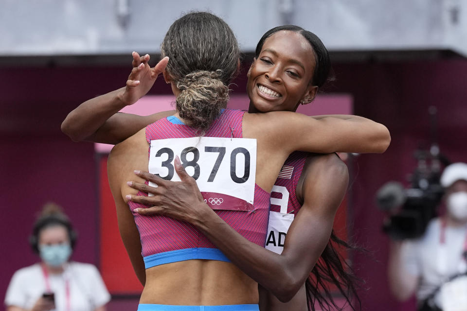Sydney McLaughlin, left, of the U.S., embraces Dalilah Muhammad, after their semifinal of the women's 400 meters at the 2020 Summer Olympics on Wednesday. (AP Photo/David J. Phillip) - Credit: AP