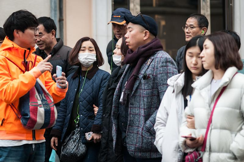 Tourists wearing masks walk in downtown Rome, Friday, Jan. 31, 2020. Italy banned all flights coming from and going to China as European countries have stepped up their response to the new virus that has sickened thousands of people in China and reached 19 other countries. on January 31 , 2020 in Rome, Italy (Photo by Andrea Ronchini/NurPhoto via Getty Images)