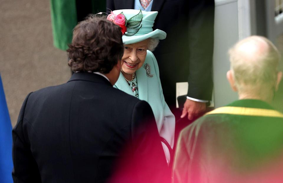 <p>Her Majesty clearly looked happy to be back at the races. </p>