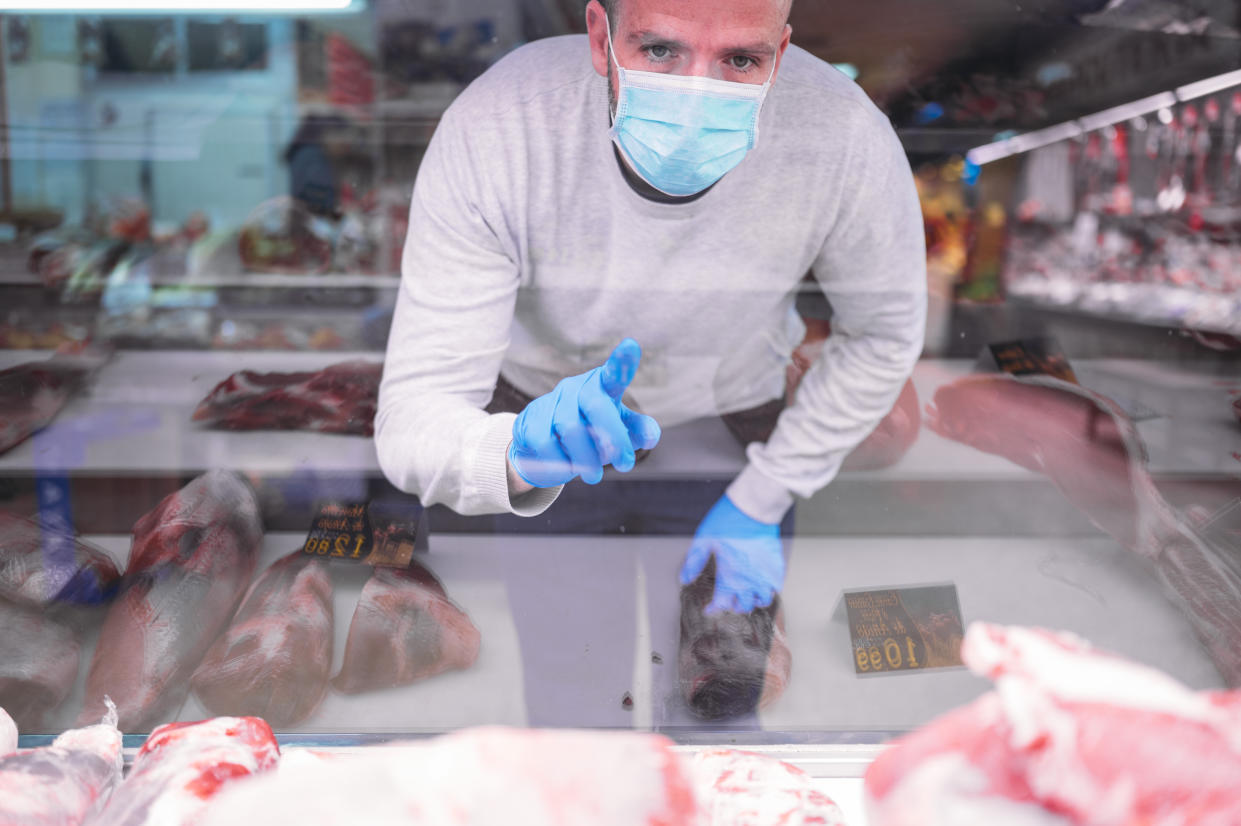 The man who wears a protective mask and gloves in the market