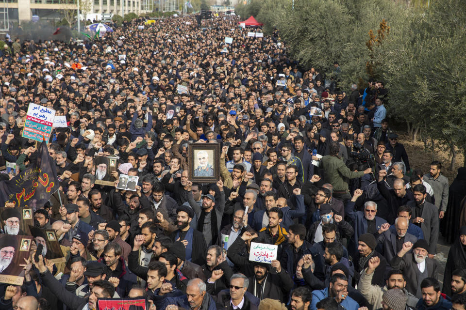 TEHRAN, IRAN - JANUARY 03: Protesters hold up photographs as people demonstrate after the U.S. airstrike in Iraq that killed Iranian Revolutionary Guard Gen. Qasem Soleimani on January 3, 2020 in Tehran, Iran. Iran has vowed 'harsh retaliation' for the U.S. airstrike near Baghdad's airport that killed Tehran's top general as tensions soared in the wake of the targeted killing. (Photo by Majid Saeedi/Getty Images)