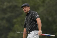 Bryson DeChambeau watches his putt on the seventh hole during the third round of the Masters golf tournament on Saturday, April 10, 2021, in Augusta, Ga. (AP Photo/Charlie Riedel)