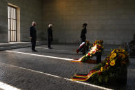 Britain's Prince Charles, Prince of Wales, left, and German President Frank-Walter Steinmeier pay their respect during a wreath laying ceremony on national Memorial Day at the Neue Wache in Berlin, on Nov. 15, 2020. The royals are in the German capital for a wreath laying ceremony on national Memorial Day at Neue Wache and a visit to parliament on November 15, 2020. ( Odd ANDERSEN / Pool via AP)