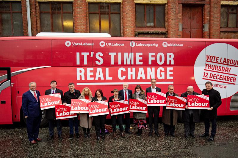 Labour unveils the party battle bus while on the General Election campaign trail in Liverpool, party members including (left to right) Peter Dowd, Dan Carden, Ian Byrne, Kim Johnson, Labour supporter , Maria Eagle, Jeremy Corbyn, Lucy Powell, Bill Esterson, Labour supporter, Joe Anderson, Steve Rotherham. PA Photo. Picture date: Thursday November 7, 2019. See PA story POLITICS Election Labour. Photo credit should read: Jacob King/PA Wire