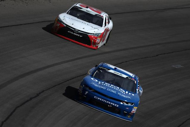 "LAS VEGAS, NV – MARCH 03: Elliott Sadler, driver of the #1 OneMain Financial Chevrolet, leads <a class=""link rapid-noclick-resp"" href=""/nascar/sprint/drivers/3716/"" data-ylk=""slk:Christopher Bell"">Christopher Bell</a>, driver of the #20 Rheem-Smurfit Kappa Toyota, during the NASCAR Xfinity Series Boyd Gaming 300 at Las Vegas Motor Speedway on March 3, 2018 in Las Vegas, Nevada. (Photo by Sean Gardner/Getty Images)"
