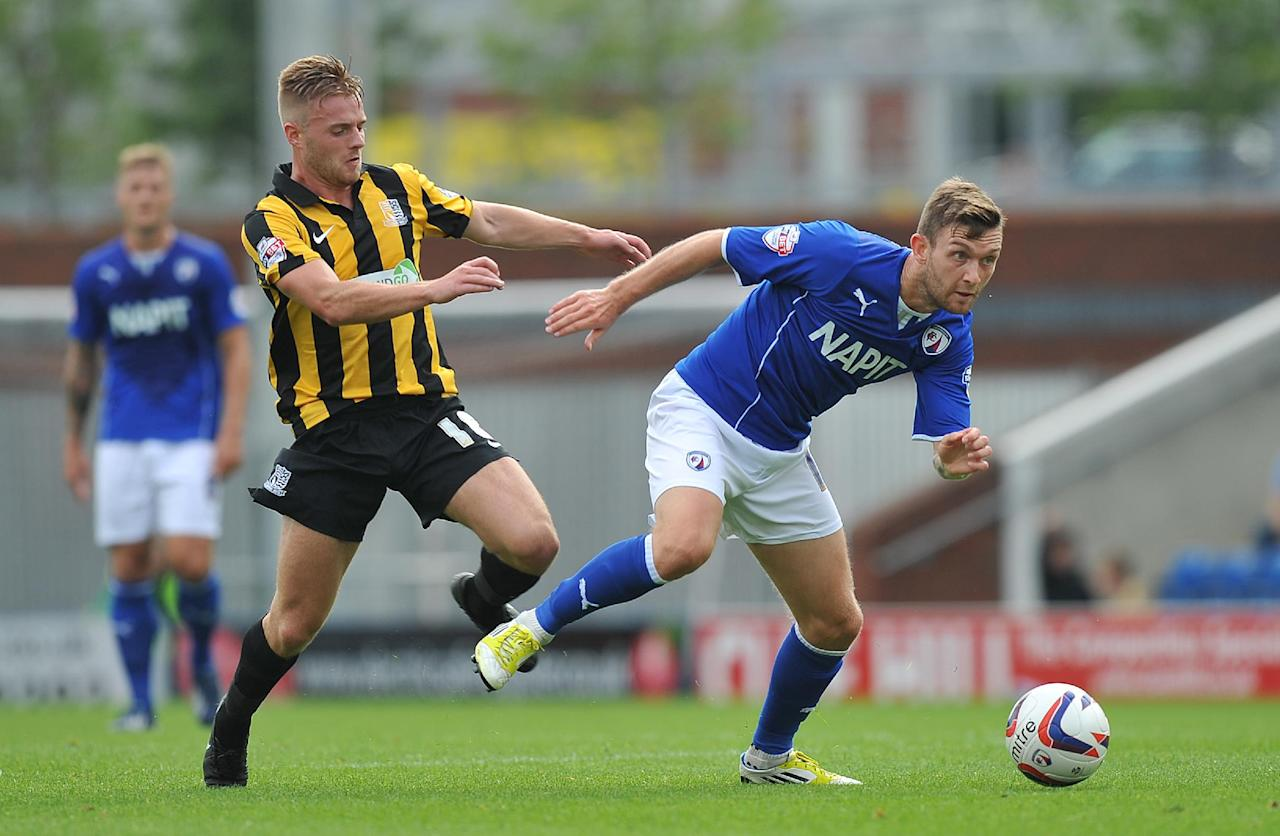 Chesterfield's Jimmy Ryan gets past Southend United's Conor Clifford during the Sky Bet Football League Two match at the Proact Stadium, Chesterfield.
