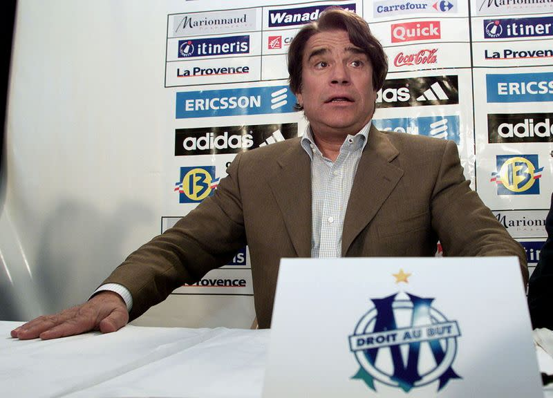 FILE PHOTO: Bernard Tapie, the former chairman of the French soccer team Olympique de Marseille, at Marseille stadium