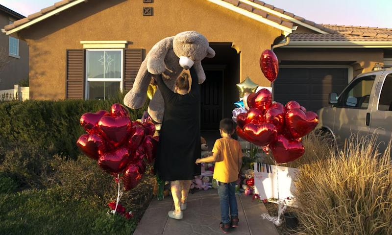 Neighbors drop off gifts for the Turpin children in Perris, California, on Thursday.