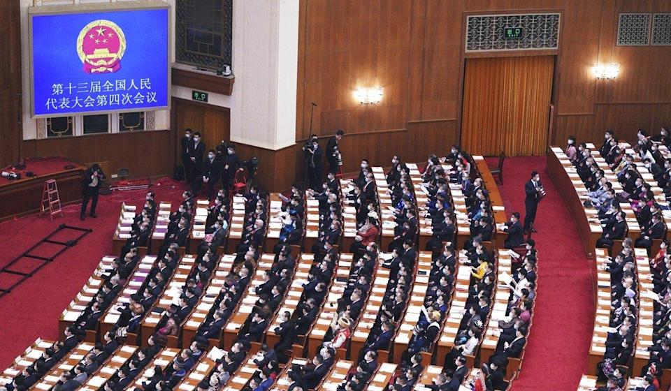 The new policy is set out in the next five-year plan tabled at the annual legislative sessions in Beijing. Photo: Xinhua