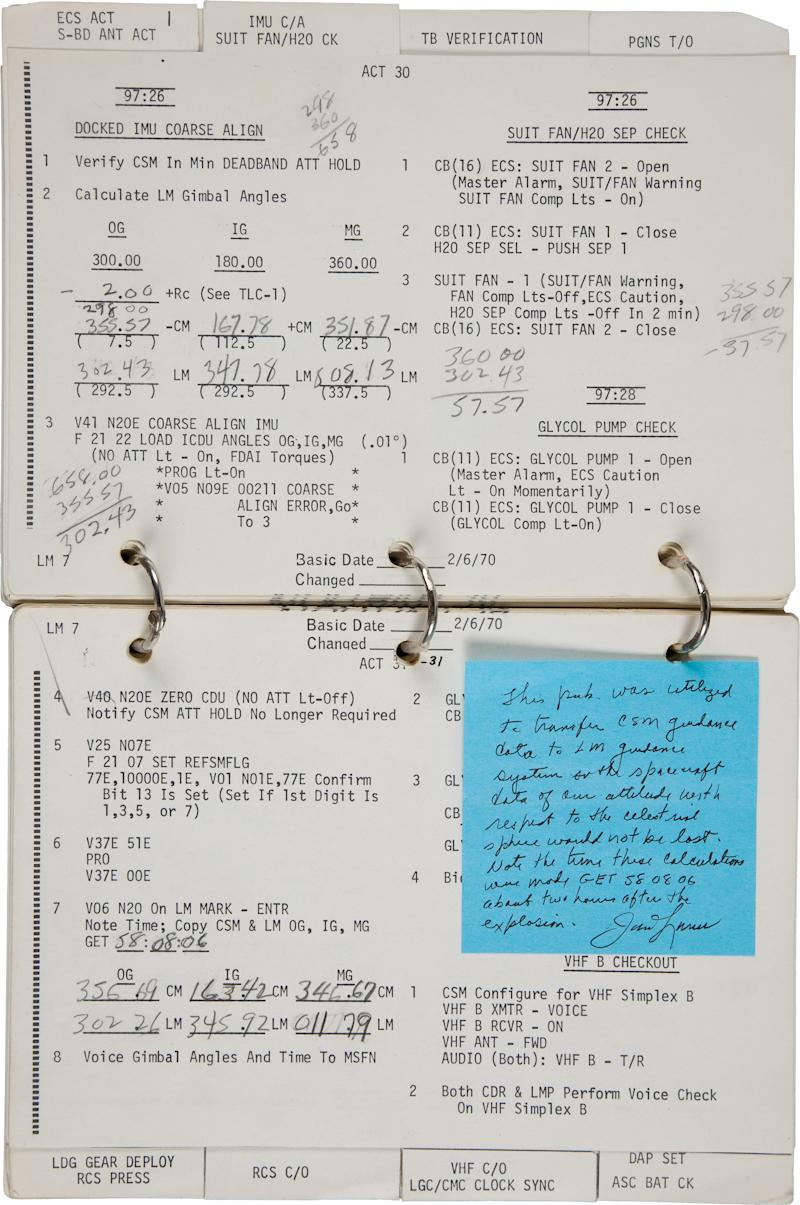 CORRECTS THAT PHOTO IS A FILE PHOTO -- FILE- A Nov. 23, 2011 file photo released by Heritage Auctions shows a a key page from the Apollo 13 Lunar Module Checklist with handwriting by Commander James Lovell. The list shows calculations made by Commander James Lovell that helped him and his crew navigate the damaged aircraft back to earth. NASA is questioning whether Lovell has the right to sell a 70-page checklist from the flight that included his handwritten calculations. The document was sold at auction in November for  $388.000. The sale has been suspended pending the outcome of the inquiry. (AP Photo/Heritage Auctions,File)
