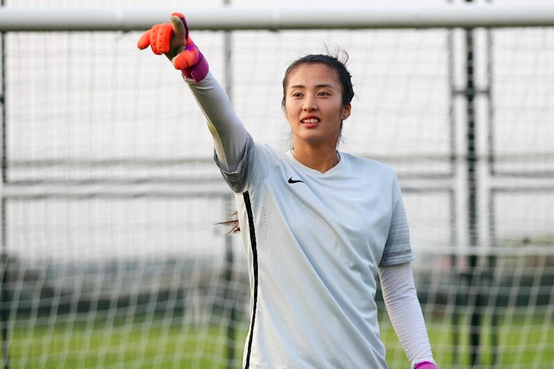 She s gloving it  China goalkeeper rejected catwalk for football a8bbc3fa46