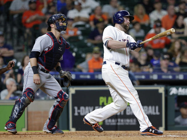 Houston Astros catcher Brian McCann (16) watches his two-run home run ball in front of Cleveland Indians catcher Yan Gomes during the seventh inning of a baseball game, Sunday, May 20, 2018, in Houston. (AP Photo/Michael Wyke)