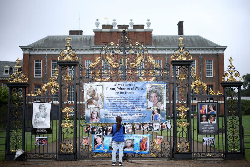 A person looks at tributes for Britain's Princess Diana, outside Kensington Palace in London