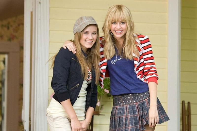 2009, and Hannah is growing up: Cyrus with Emily Osment in Hannah Montana: The Movie