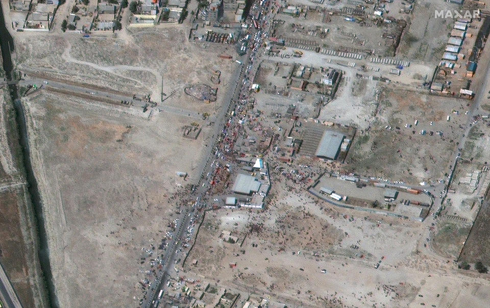 Crowds gather at the northeastern gate at Hamid Karzai International Airport, in Kabul, Afghanistan on Friday, Aug. 27, 2021. Source: Satellite Image ©2021 Maxar Technologies via AP
