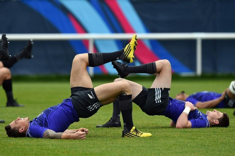 New Zealand All Blacks centre Sonny Bill Williams (L) and New Zealand All Blacks fly-half Beauden Barrett take part in a team training session in Sunbury-on-Thames, west of London, on October 22, 2015