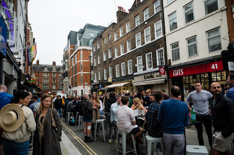 """Customers enjoying their drinks in Soho during the """"Super Saturday"""" in London, Britain, 04 July 2020. Pubs, restaurants, hotels and hairdressers in England reopen as part of plans to further ease the coronavirus disease (COVID-19) lockdown. (Photo by Maciek Musialek/NurPhoto via Getty Images)"""