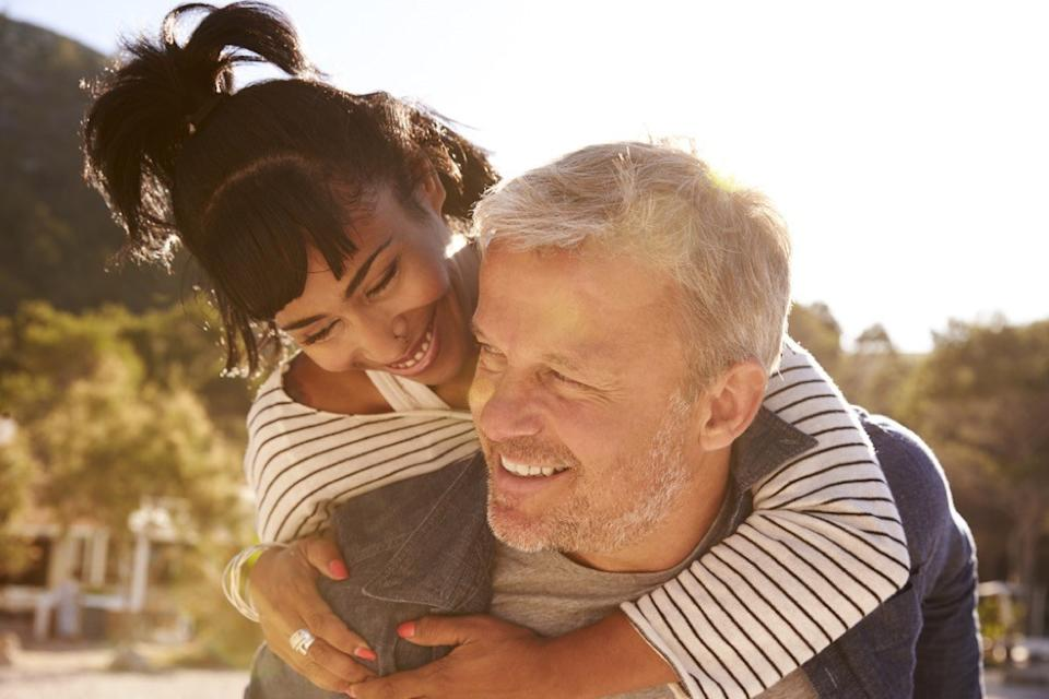 older couple flirting outside, healthy sex after 40