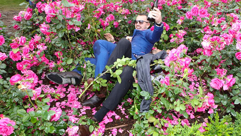 Drunk punters, pictured here wrestling in the bushes after the 2018 Melbourne Cup.
