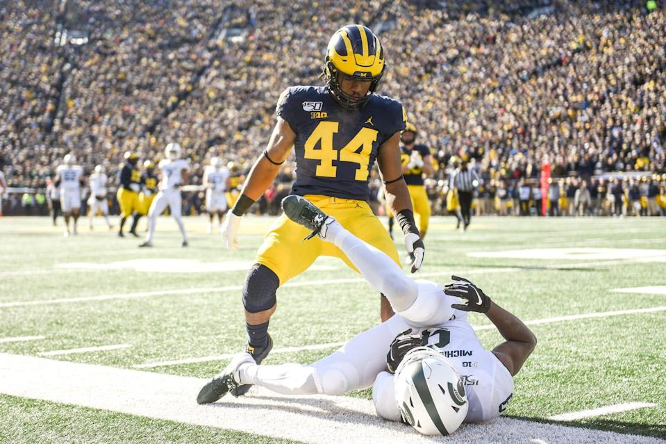 Michigan's Cameron McGrone stands over Michigan State's Andrew Williams after a play during the first quarter on Saturday, Nov. 16, 2019, at Michigan Stadium in Ann Arbor.