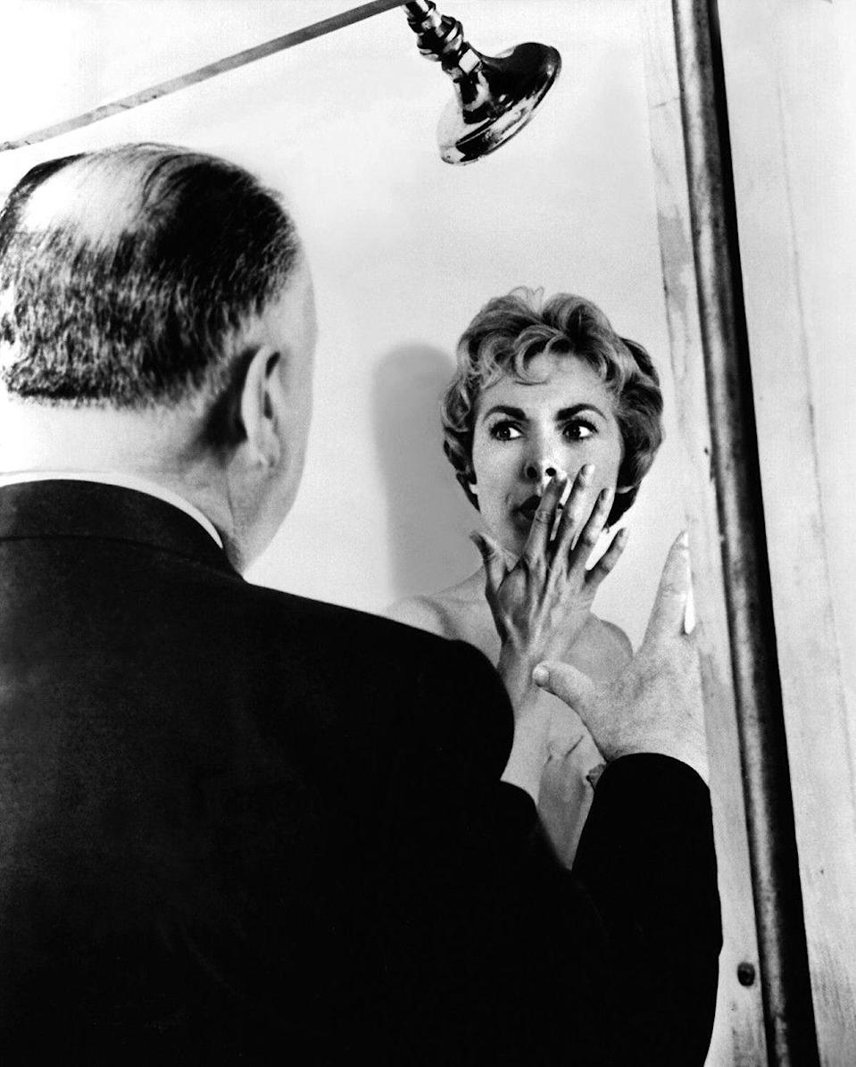 <p>Janet Leigh listens intently to director Alfred Hitchcock as the two discuss the movie's famous shower scene in <em>Psycho</em>. </p>