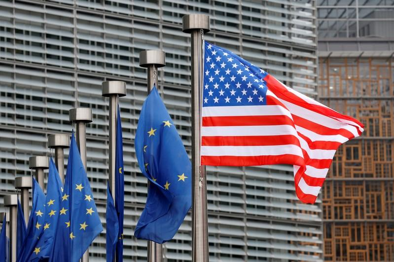 FILE PHOTO:  U.S. and EU flags are pictured during the visit of Vice President Pence to the European Commission headquarters in Brussels