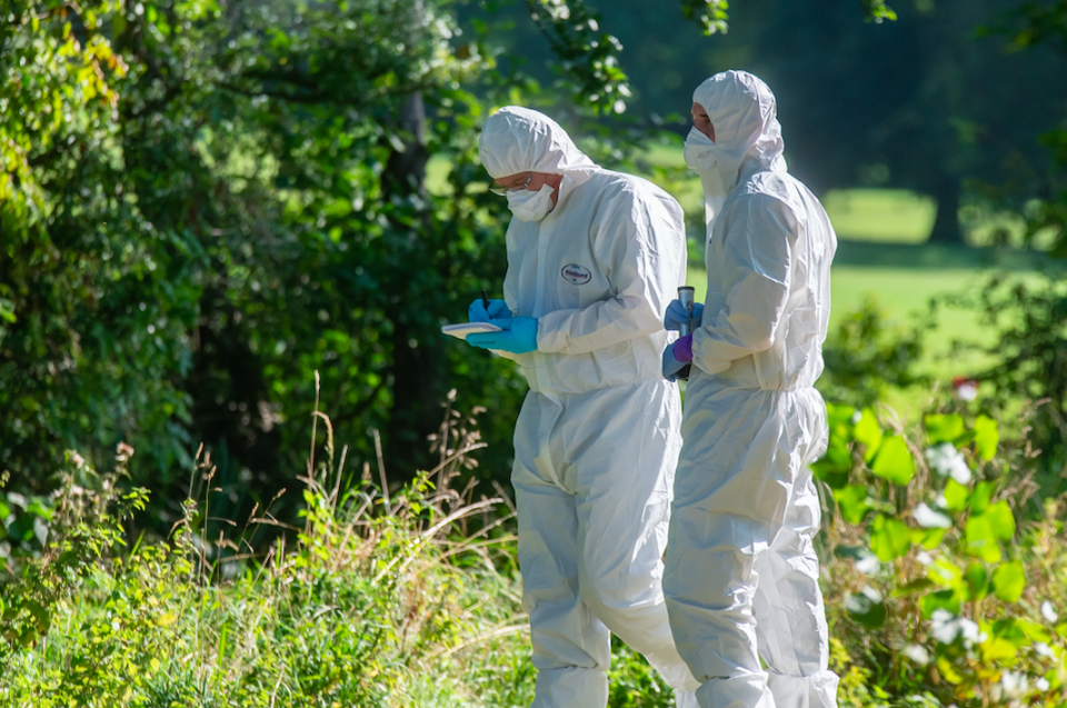 Forensic officers search for clues after Keeley Bunker was found dead last year. (SWNS)