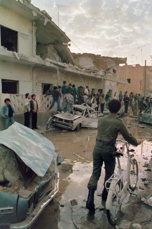 People look at the damage caused by US bombs in Tripoli on April 19, 1986 after a US air raid in retaliation for alleged Libyan terrorist attacks on American targets