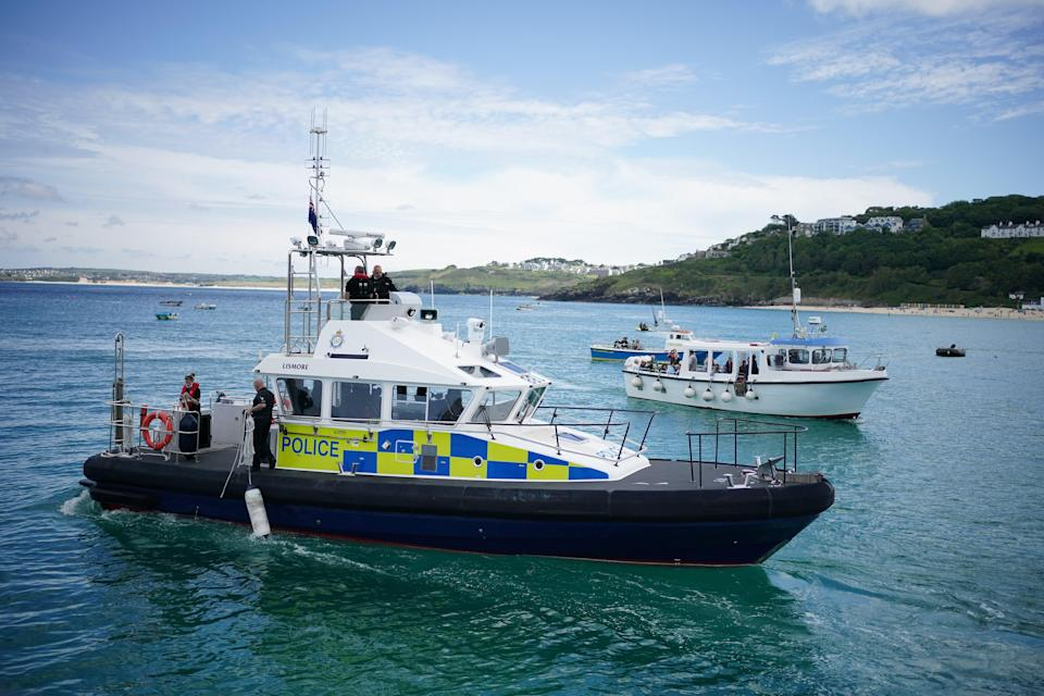 Police boat activity in St Ives harbour (PA)