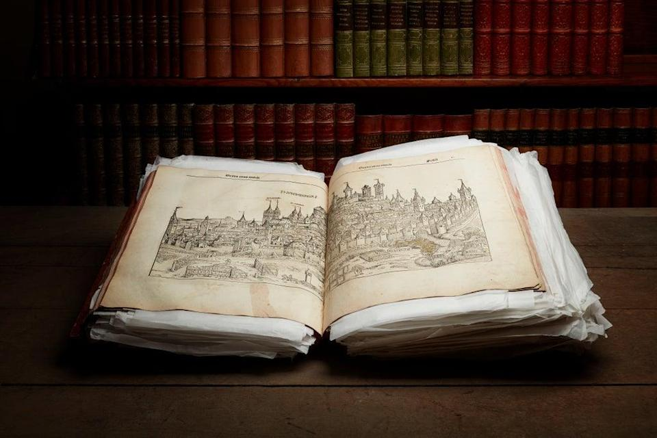 The book, a copy of the Nuremberg Chronicle, is to go under the hammer at auctioneers Lyon & Turnbull (PA)