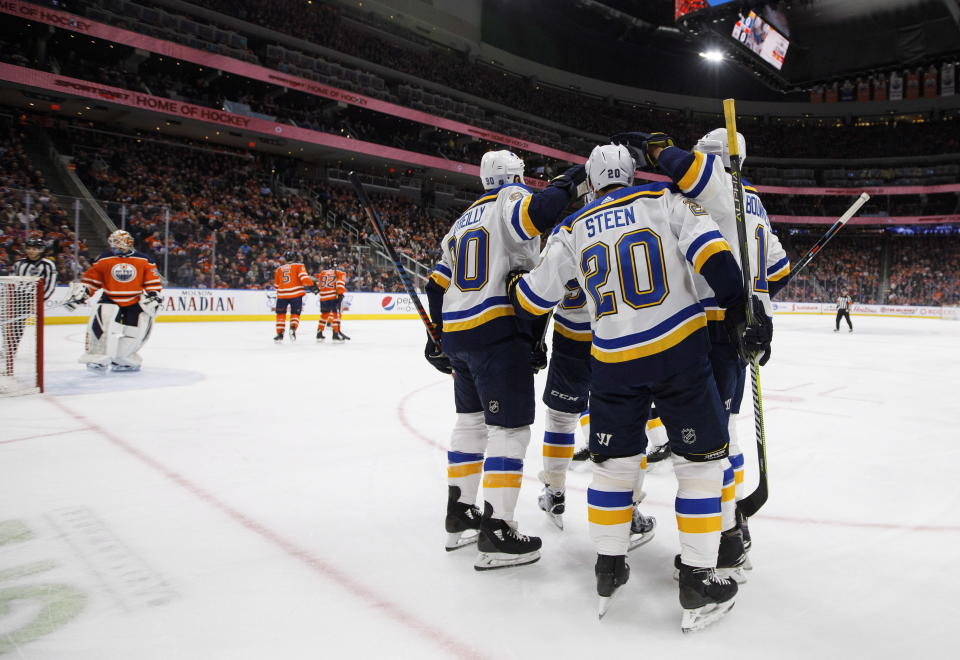 St. Louis Blues celebrate a goal abasing the Edmonton Oilers during the first period of an NHL hockey game, Tuesday, Dec. 18, 2018 in Edmonton, Alberta. (Jason Franson/The Canadian Press via AP)