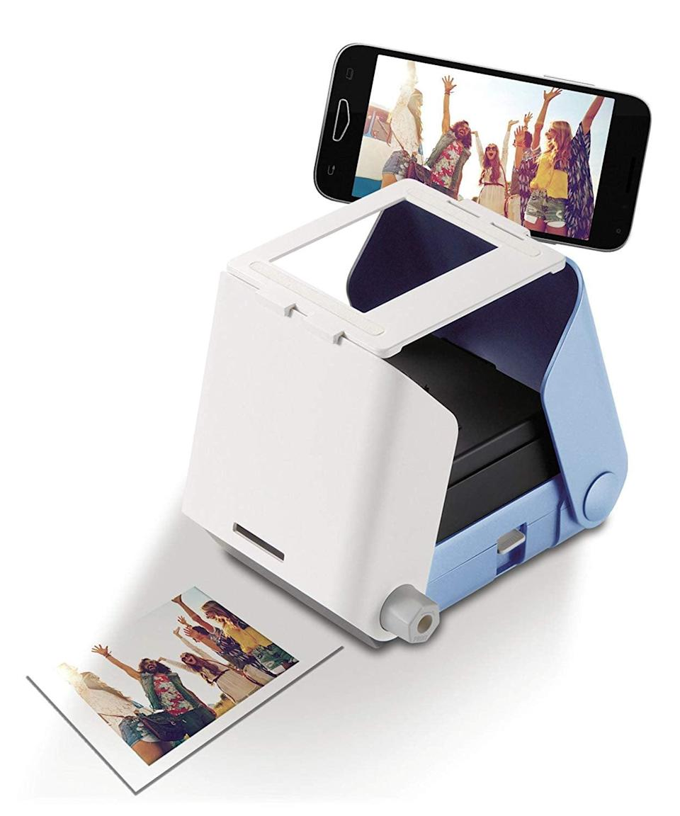 <p>They can easily print their favorite memories out with this <span>Smartphone Picture Printer</span> ($34).</p>