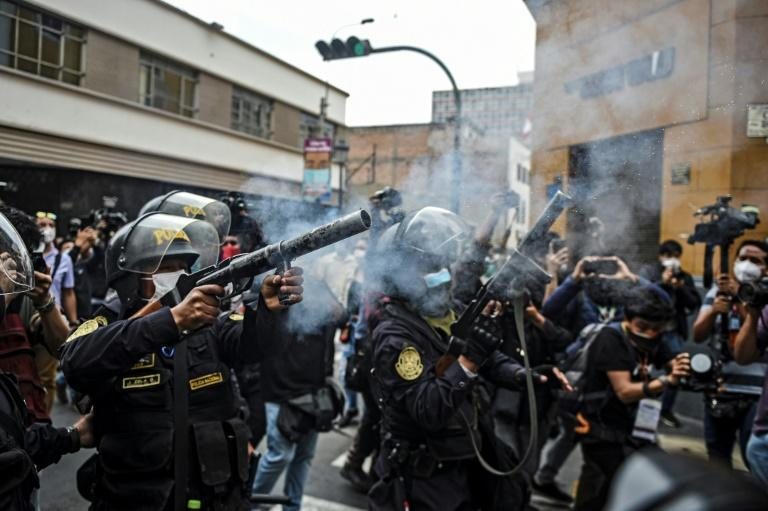 Riot police fire tear gas as they try to disperse supporters of ousted Peruvian president Martin Vizcarra in Lima, on November 10, 2020