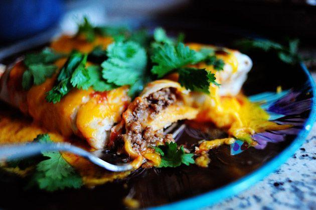 """<p>Warm up refried beans with shredded cheese and use as a filling for burritos. Ree adds ground beef, too, but you can also add veggies, avocado, or whatever you like!</p><p><a href=""""https://www.thepioneerwoman.com/food-cooking/recipes/a11697/brown-hot-and-plenty-of-it-vol-i/"""" rel=""""nofollow noopener"""" target=""""_blank"""" data-ylk=""""slk:Get Ree's recipe."""" class=""""link rapid-noclick-resp""""><strong>Get Ree's recipe. </strong></a></p>"""