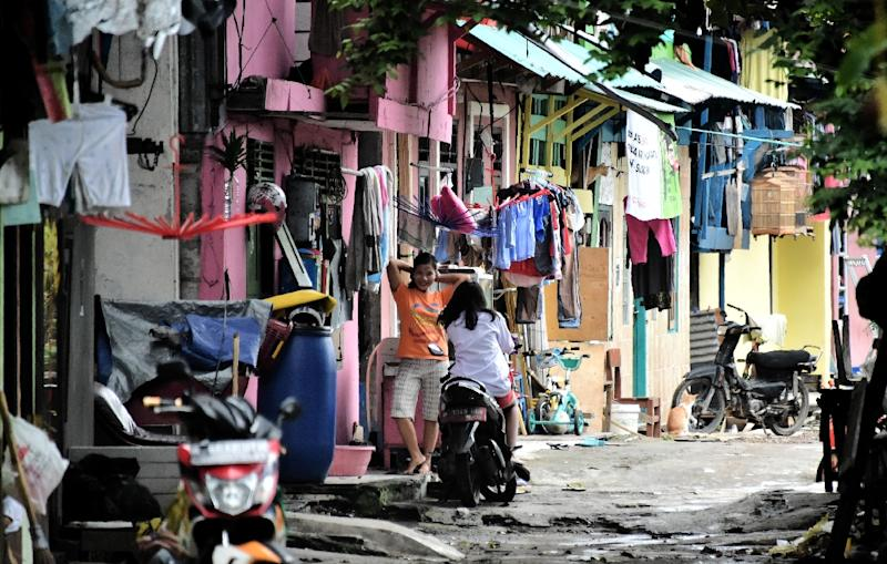 Residents of Tongkol kampung have transformed the neighbourhood into a model of clean and green living in an effort to fight off the threat of eviction (AFP Photo/Bay ISMOYO)
