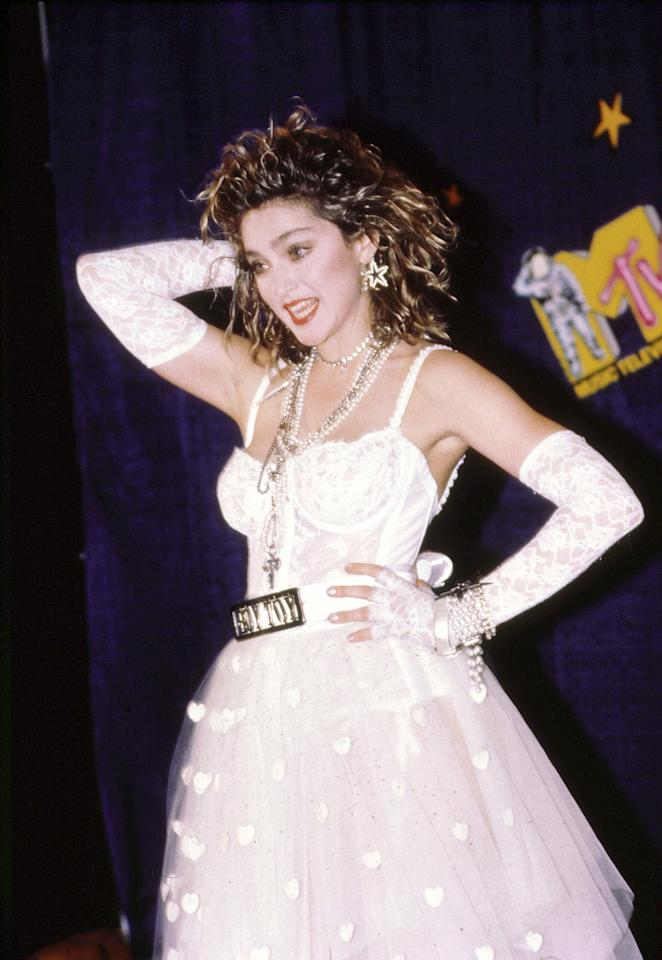 Posing at the MTV Music Awards, Madonna wore her tousled blonde waves with a coral red lip.