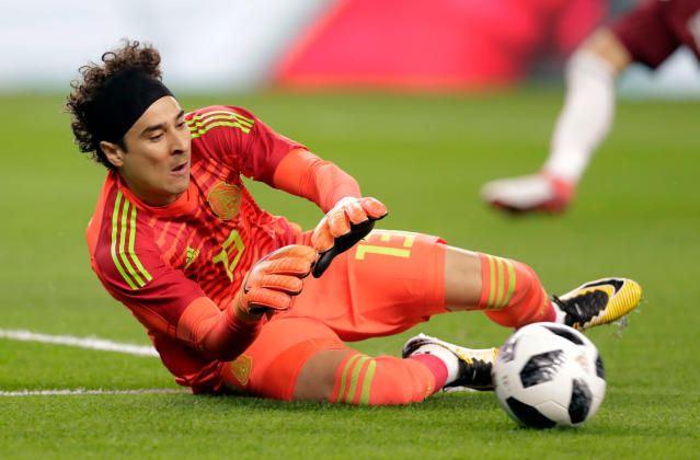 In this image taken on Tuesday, March 27, 2018 Mexico goalkeeper Guillermo Ochoa makes a save a shot by Croatia in the first half of a friendly soccer match in Arlington, Texas, Tuesday, March 27, 2018. (AP Photo/Tony Gutierrez)