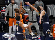 Phoenix Suns guard Chris Paul, back left, watches his shot over Denver Nuggets center Nikola Jokic, back right, and guard Gary Harris that went in with 7.3 seconds left in an NBA basketball game Friday, Jan. 1, 2021, in Denver. The Suns won 106-103. (AP Photo/David Zalubowski)