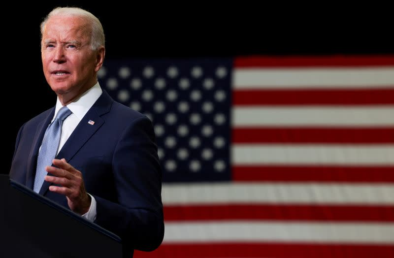 """FILE PHOTO: U.S. President Joe Biden delivers remarks on his proposed """"American Families Plan"""" legislation at McHenry County College during a visit to the northwest Chicago suburb Crystal Lake, Illinois, U.S., July 7, 2021."""