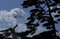 Hideki Matsuyama of Japan watches his tee shot on the 11th hole during the third round of the men's golf event at the 2020 Summer Olympics on Saturday, July 31, 2021, in Kawagoe, Japan. (AP Photo/Matt York)