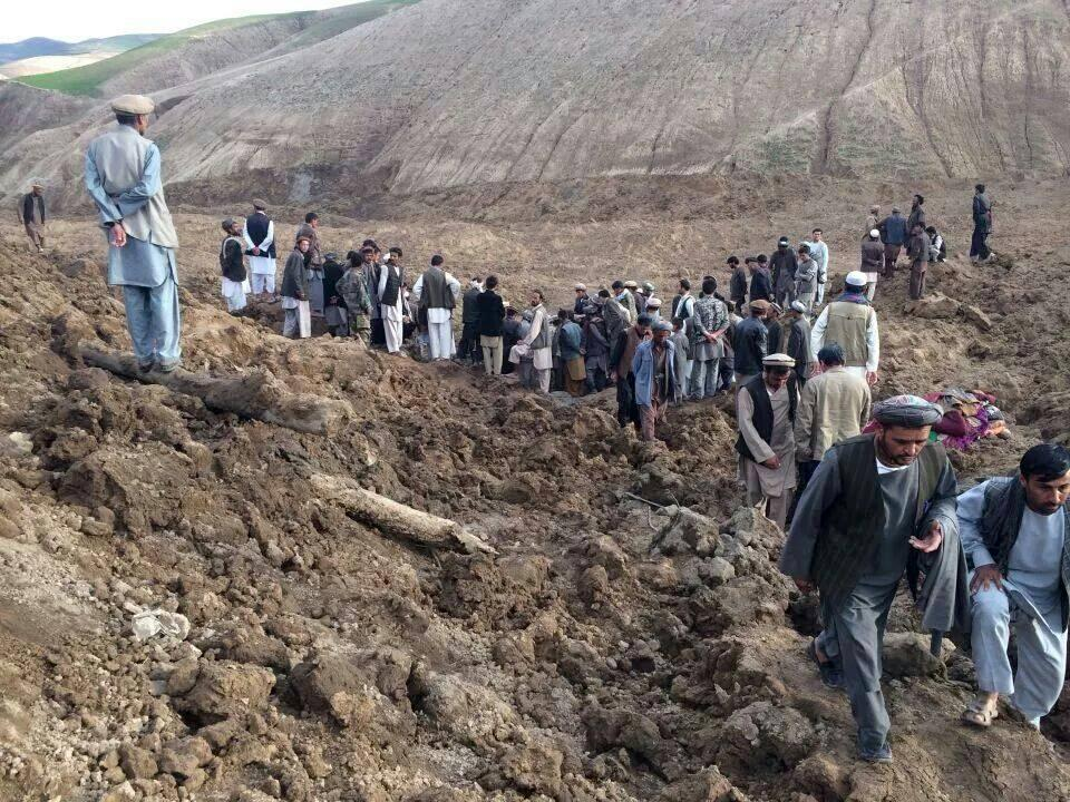 CORRECTS PHOTO CREDIT TO HOMAYOON RAHMANI - In this photo provided by Homayoon Rahmani, the chief of road reconstruction program in the Afghan Rural and Rehabilitation Development Ministry, Afghans search for survivors after a massive landslide landslide buried a village Friday, May 2, 2014 in Badakhshan province, northeastern Afghanistan, which Afghan and U.N. officials say left hundreds of dead and missing missing.(AP Photo/Homayoon Rahmani)