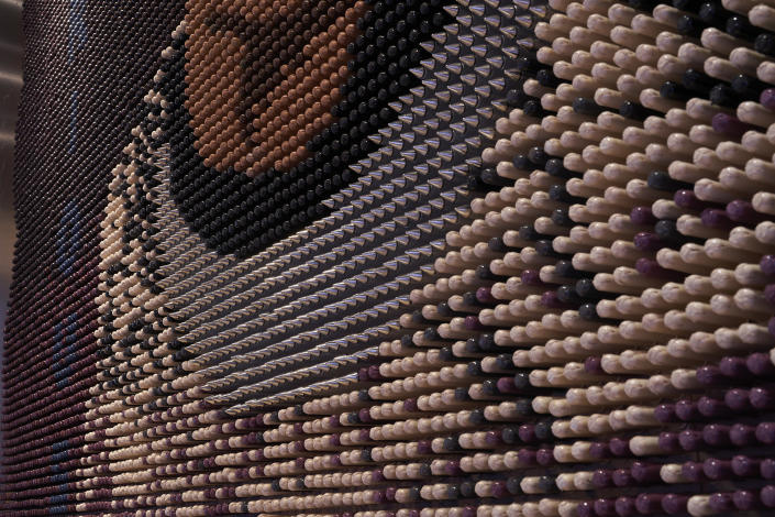 Constructed using 20,000 hand-painted tampons donated by CORA, Ruth Bader Ginsburg's mural shares a message of female unity while promoting sustainability and opportunity for women. Photo Credit: Mike Schwartz Photography